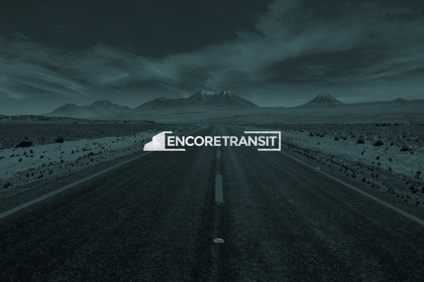Encore Transit white logo design on dark blue photo background