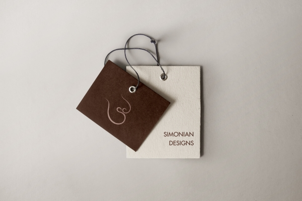 Branded product tags with logo and wordmark